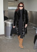 Debra Messing Arriving at LAX January 14, 2012 HQ x 7
